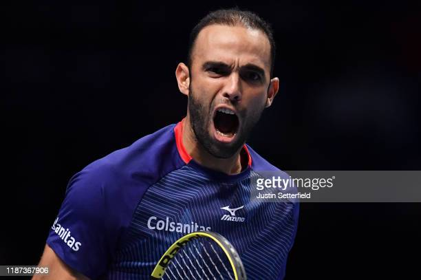 Juan Sebastian Cabal playing partner of Robert Farah of Colombia celebrates in their doubles match against JeanJulien Rojer of The Netherlands and...