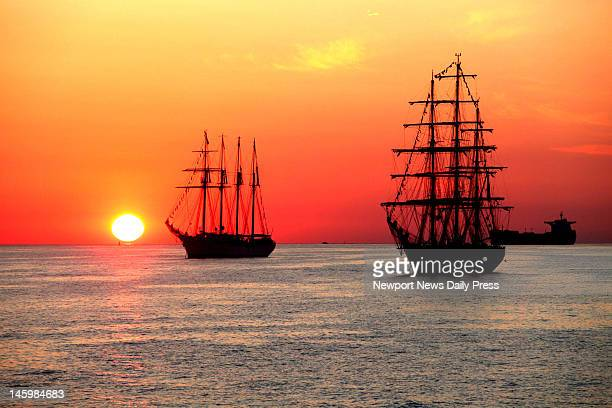 Juan Sebastian De Elcano of Spain lreft and Cisne Branco of Brazil line up with sunrise for OpSail 2012 near Hampton Roads Virigina Friday June 8 2012
