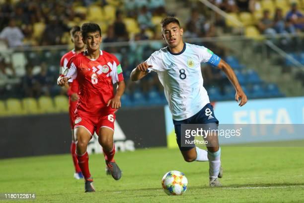 Juan Sebastian Sforza of Argentina and Shukhrat Elmurodov of Tajikistan during the FIFA U17 World Cup Brazil 2019 Group E match between Argentina and...