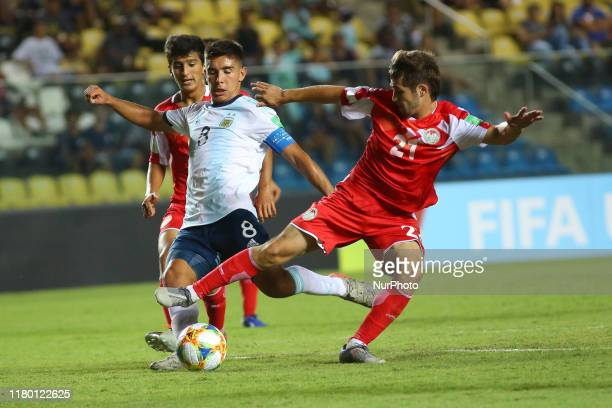 Juan Sebastian Sforza of Argentina vies Isroil Kholov of Tajikistan during the FIFA U17 World Cup Brazil 2019 Group E match between Argentina and...