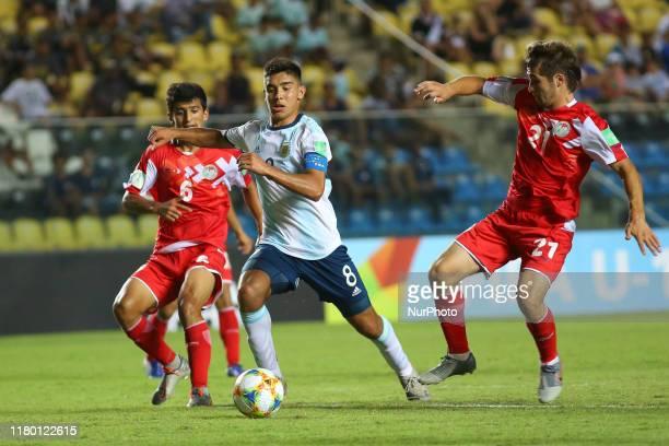 Juan Sebastian Sforza of Argentina vies Shukhrat Elmurodov and Isroil Kholov of Tajikistan during the FIFA U17 World Cup Brazil 2019 Group E match...
