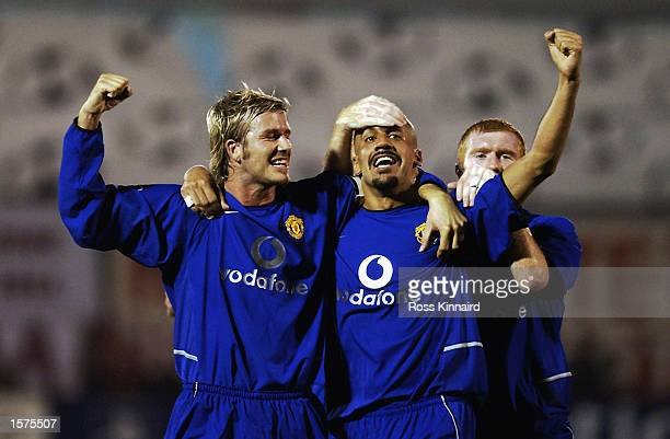 Juan Sebastian Veron of Manchester United celebrates with David Beckham after scoring the second goal during the UEFA Champions League Group F match...