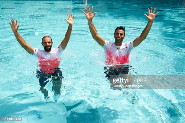 Juan Sebastián Cabal of Colombia and Robert Farah of Colombia dive in the swimming pool after defeating Horia Tecau of Romania and Kevin Krawietz of...