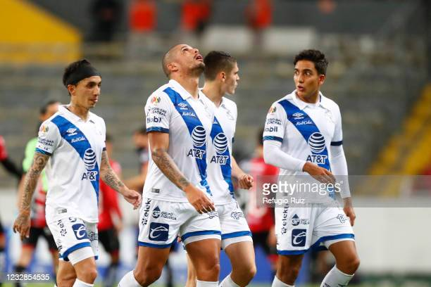 Juan Segovia of Puebla and teammates react during the quarterfinals first leg match between Atlas and Puebla as part of the Torneo Guard1anes 2021...