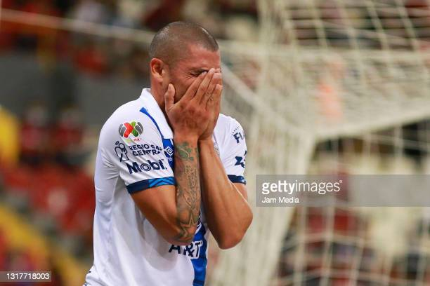 Juan Segovia of Puebla reacts during the quarterfinals first leg match between Atlas and Puebla as part of the Torneo Guard1anes 2021 Liga MX at...