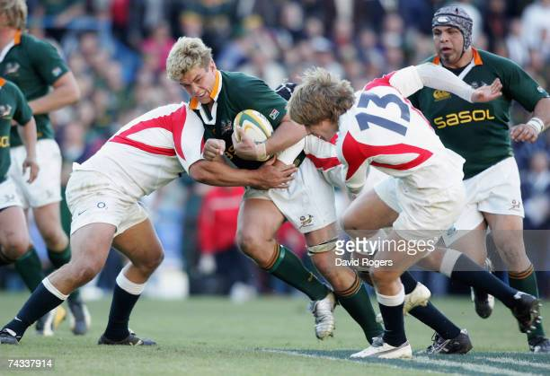 Juan Smith of South Afirca takes on Mathew Tait during the rugby union international match between South Africa and England at Vodacom Park on May 26...