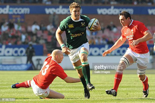 Juan Smith of South Africa gets passed Tom Shanklin and Gareth Delve of Wales during the second International Test match between South Africa and...