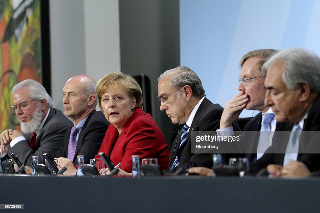Juan Somavia, director-general of the International Labour Organization (ILO), from left, Pascal Lamy, director general of the World Trade Organization (WTO), Angela Merkel, Germany's chancellor, Angel Gurria, secretary-general of the Organization for Economic Cooperation and Development (OECD), Robert Zoellick, president of the World Bank, and Dominique Strauss-Kahn, managing director of the International Monetary Fund (IMF), hold a news conference at the German federal chancellory in Berlin, Germany, on Wednesday, April 28, 2010. Merkel and the IMF pledged to step up efforts to overcome the Greek fiscal crisis as Standard & Poor's downgraded Spain and investors sold bonds in Europe's most indebted nations. Photographer: Michele Tantussi/Bloomberg via Getty Images