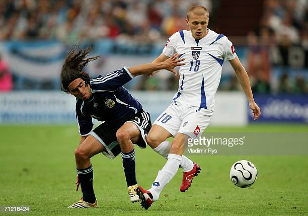 Juan Sorin of Argentina battles with Zvonimir Vukic of Serbia Montenegro during the FIFA World Cup Germany 2006 Group C match between Argentina and...