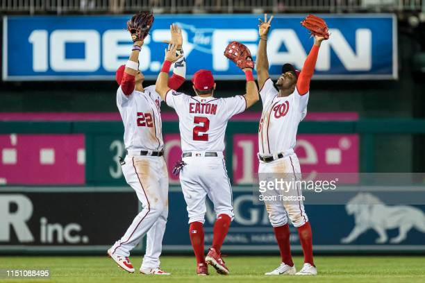 Juan Soto Adam Eaton and Victor Robles of the Washington Nationals celebrate after the game against the Philadelphia Phillies at Nationals Park on...