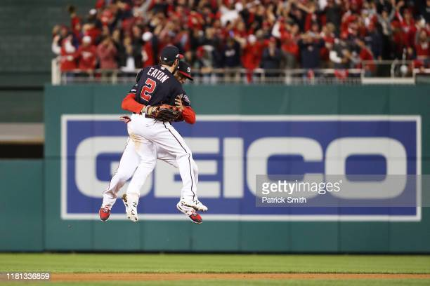 Juan Soto and Adam Eaton of the Washington Nationals celebrate winning game four and the National League Championship Series against the St Louis...