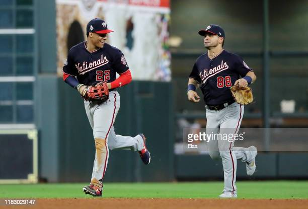 Juan Soto and Gerardo Parra of the Washington Nationals celebrate their 123 win over the Houston Astros in Game Two of the 2019 World Series at...
