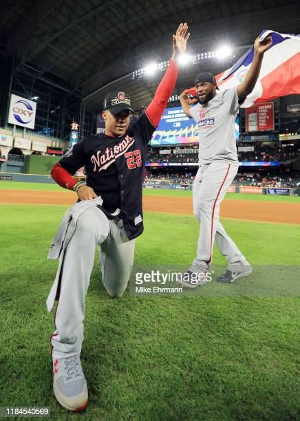 Juan Soto and Howie Kendrick of the Washington Nationals celebrate after the team defeated the Houston Astros 62 in Game Seven to win the 2019 World...