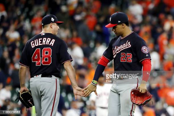 Juan Soto and Javy Guerra of the Washington Nationals celebrate their 12-3 win over the Houston Astros in Game Two of the 2019 World Series at Minute...
