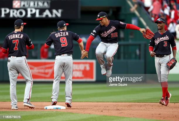 Juan Soto Brian Dozier Trea Turner and Michael A Taylor of the Washington Nationals celebrate after the final out to defeat the St Louis Cardinals 31...