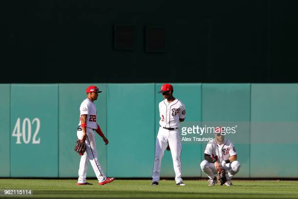 Juan Soto Michael Taylor and Bryce Harper of the Washington Nationals wait for a pitching change during a game against the San Diego Padres at...