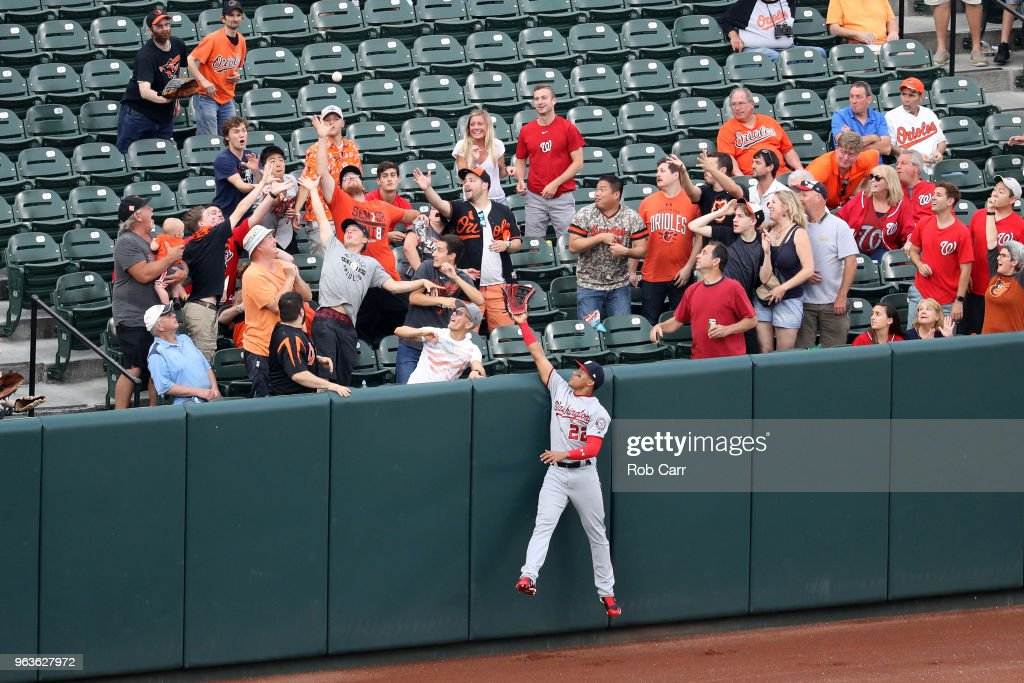 Juan Soto #22 of the Washington Nationals can't reach a solo home run hit by Manny Machado #13 of the Baltimore Orioles (not pictured) in the first inning at Oriole Park at Camden Yards on May 29, 2018 in Baltimore, Maryland.
