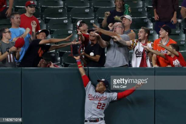 Juan Soto of the Washington Nationals can't reach a two RBI home run hit by Trey Mancini of the Baltimore Orioles during the eighth inning at Oriole...