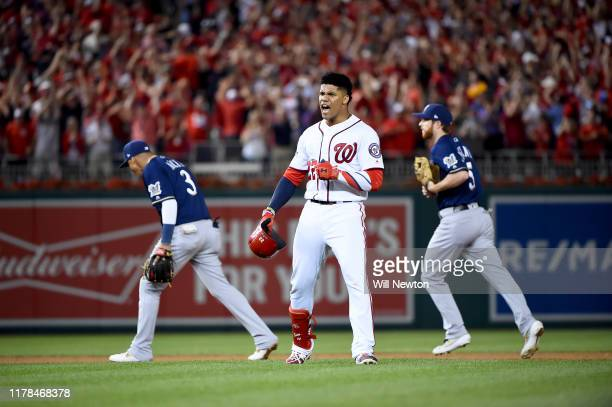 Juan Soto of the Washington Nationals celebrates after hitting a single to right field to score 3 runs off of an error by Trent Grisham of the...
