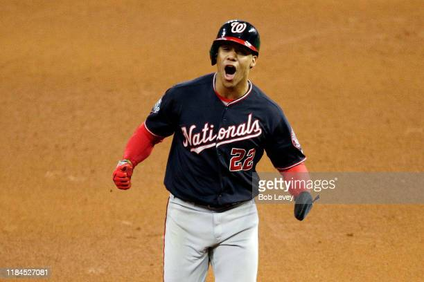 Juan Soto of the Washington Nationals celebrates as he comes home to score a run on a home run by Howie Kendrick against the Houston Astros during...