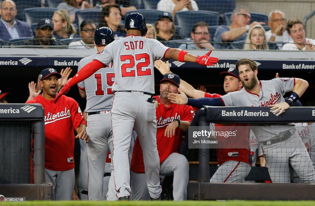 Juan Soto #22 of the Washington Nationals celebrates his fourth inning three run home run against the New York Yankees with his teammates at the dugout at Yankee Stadium on June 13, 2018 in the Bronx borough of New York City.