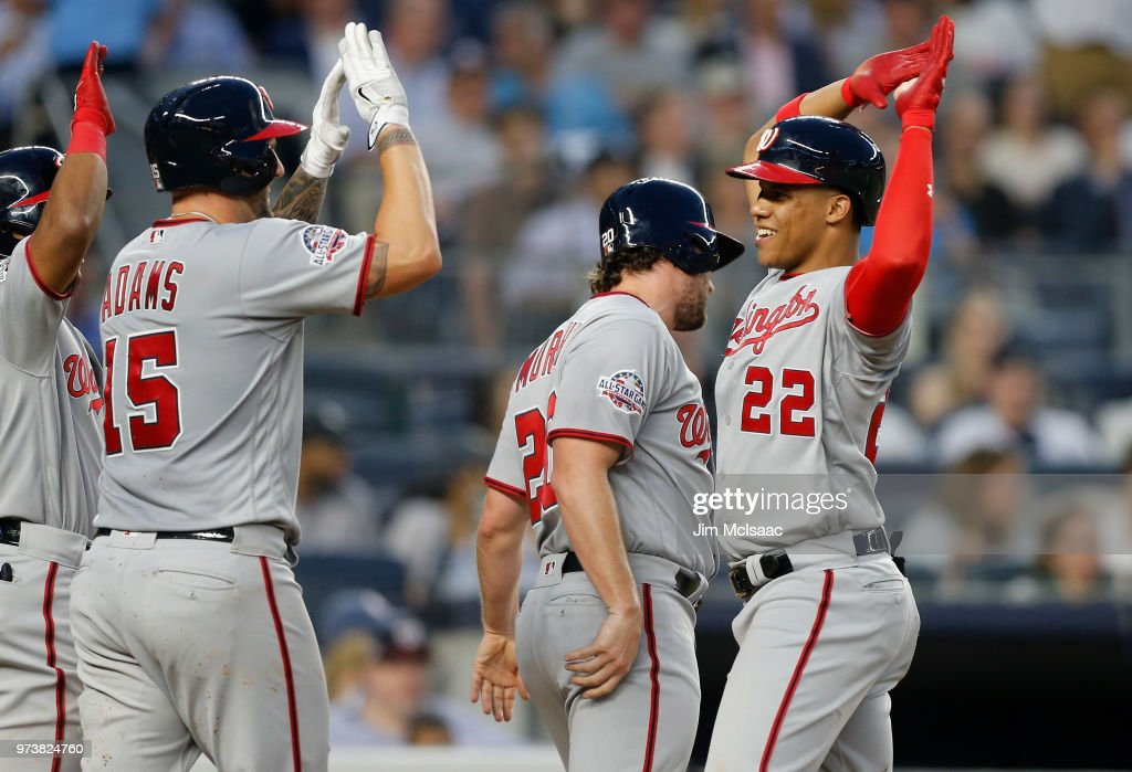 Juan Soto #22 of the Washington Nationals celebrates his fourth inning three run home run against the New York Yankees with teammates Daniel Murphy #20 and Matt Adams #15 at Yankee Stadium on June 13, 2018 in the Bronx borough of New York City.
