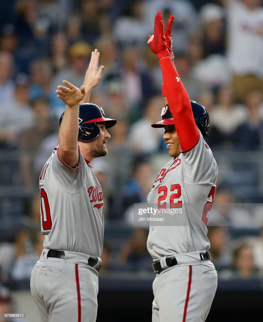 Juan Soto #22 of the Washington Nationals celebrates his fourth inning three run home run against the New York Yankees with teammate Daniel Murphy #20 at Yankee Stadium on June 13, 2018 in the Bronx borough of New York City.
