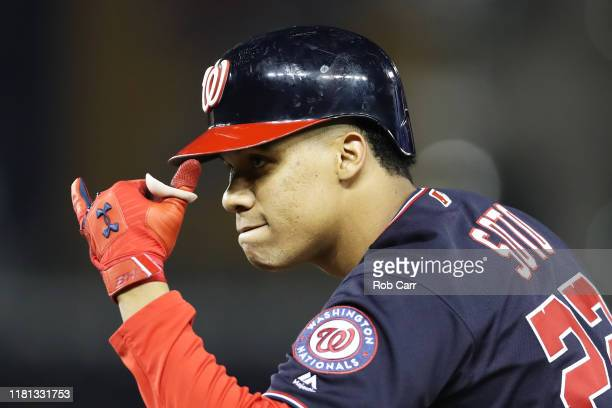 Juan Soto of the Washington Nationals celebrates his single in the seventh inning against the St Louis Cardinals during game four of the National...