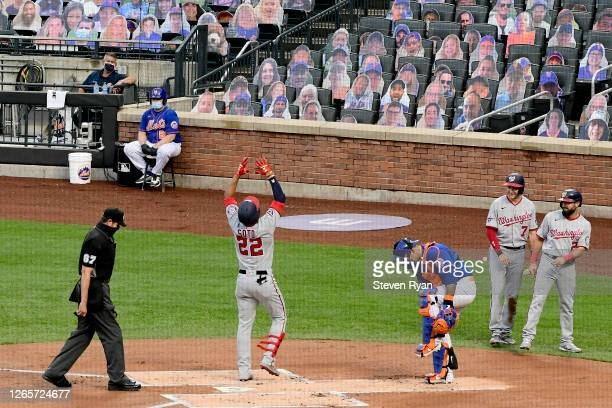 Juan Soto of the Washington Nationals celebrates his threerun home run driving in Trea Turner and Adam Eaton against the New York Mets in the first...