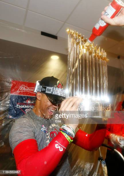 Juan Soto of the Washington Nationals celebrates in the locker room after defeating the Houston Astros in Game Seven to win the 2019 World Series at...