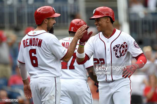 Juan Soto of the Washington Nationals celebrates with Anthony Rendon after hitting a tworun home run in the seventh inning against the Miami Marlins...