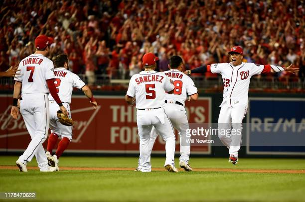 Juan Soto of the Washington Nationals celebrates with his teammates after defeating the Milwaukee Brewers with a score 4 to 3 in the National League...
