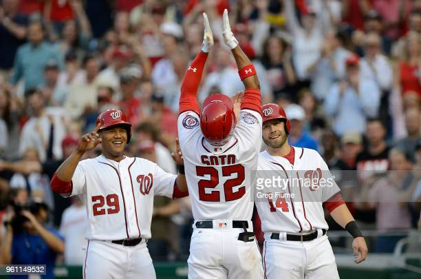 Juan Soto of the Washington Nationals celebrates with Pedro Severino and Mark Reynolds after hitting a home run in the second inning for his first...