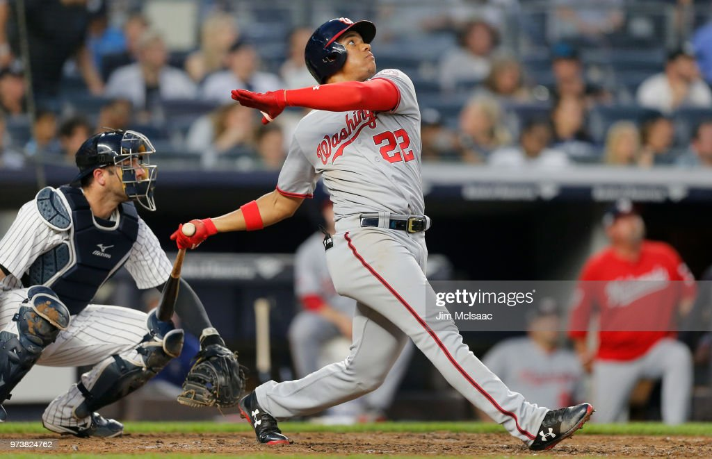 Juan Soto #22 of the Washington Nationals follows through on a fourth inning three run home run against the New York Yankees at Yankee Stadium on June 13, 2018 in the Bronx borough of New York City.