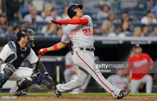 Juan Soto of the Washington Nationals follows through on a fourth inning three run home run against the New York Yankees at Yankee Stadium on June 13...