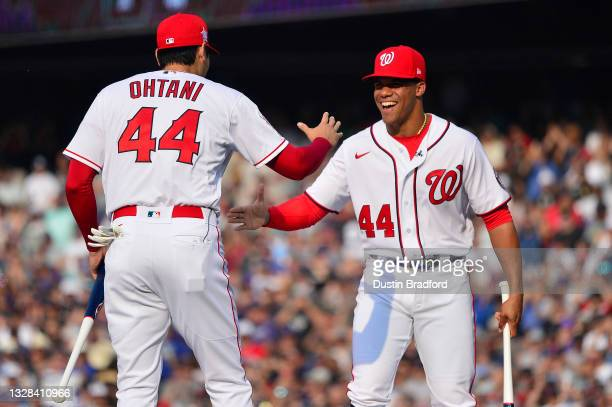 Juan Soto of the Washington Nationals greets Shohei Ohtani of the Los Angeles Angels before the start of the 2021 T-Mobile Home Run Derby at Coors...