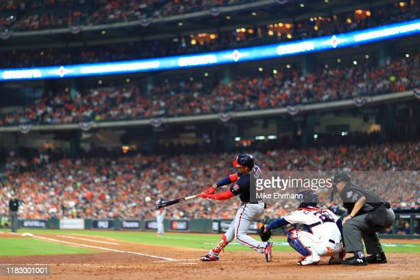 Juan Soto of the Washington Nationals hits a double against the Houston Astros during the third inning in Game Two of the 2019 World Series at Minute...