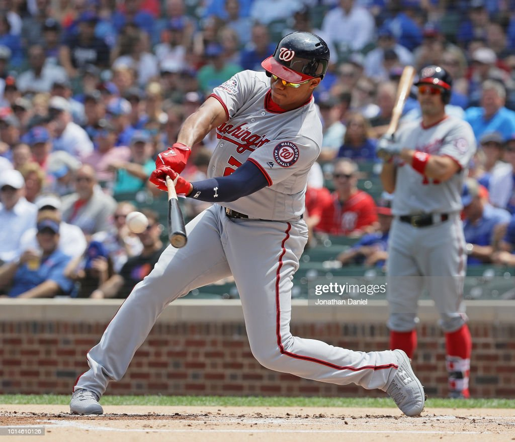 Juan Soto #22 of the Washington Nationals hits a run scoring single in the 1st inning against the Chicago Cubs at Wrigley Field on August 10, 2018 in Chicago, Illinois.