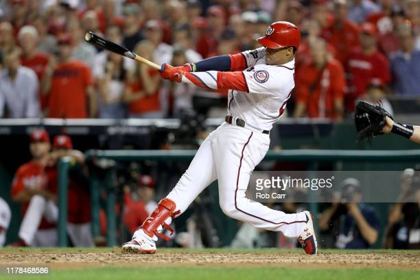 Juan Soto of the Washington Nationals hits a single to right field to score 3 runs off of an error by Trent Grisham of the Milwaukee Brewers during...