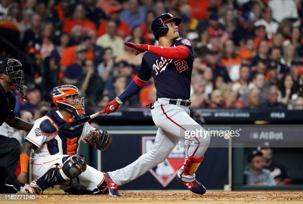 Juan Soto of the Washington Nationals hits a solo home run against the Houston Astros during the fourth inning in Game One of the 2019 World Series...