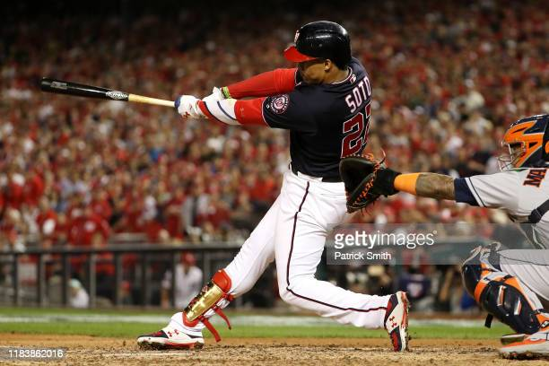 Juan Soto of the Washington Nationals hits a solo home run against the Houston Astros during the seventh inning in Game Five of the 2019 World Series...