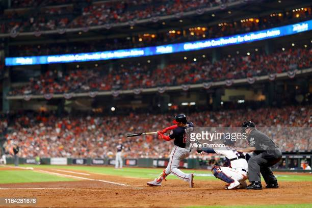 Juan Soto of the Washington Nationals hits a solo home run against the Houston Astros during the fifth inning in Game Six of the 2019 World Series at...