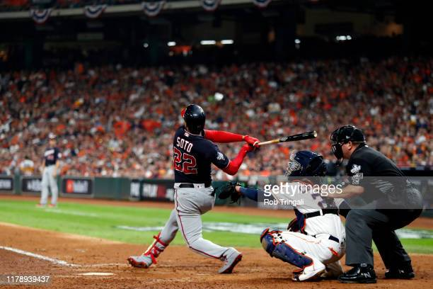 Juan Soto of the Washington Nationals hits a solo home run in the fifth inning during Game 6 of the 2019 World Series between the Washington...