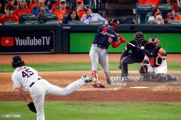 Juan Soto of the Washington Nationals hits a solo home run on a pitch from Gerrit Cole of the Houston Astros during the fourth inning in Game One of...