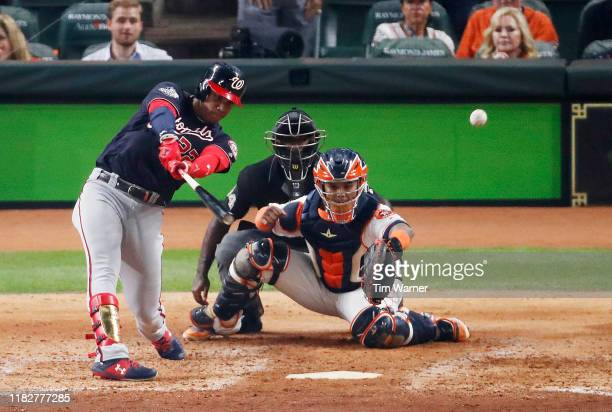 Juan Soto of the Washington Nationals hits a twoRBI double against the Houston Astros during the fifth inning in Game One of the 2019 World Series at...