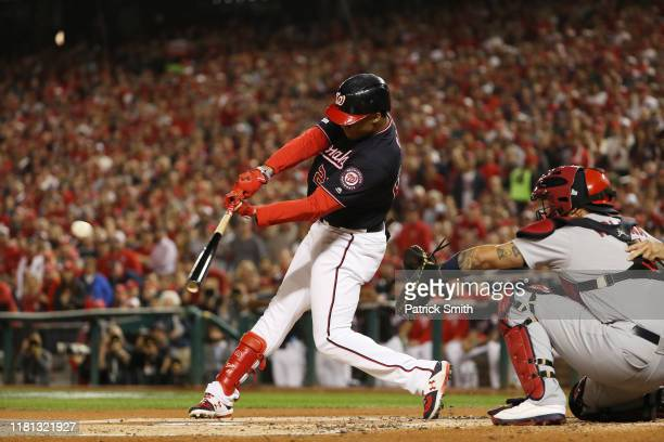 Juan Soto of the Washington Nationals hits an RBI double during game four of the National League Championship Series at Nationals Park on October 15...