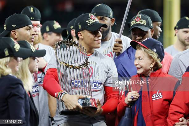 Juan Soto of the Washington Nationals holds the Commissioners Trophy after defeating the Houston Astros 62 in Game Seven to win the 2019 World Series...