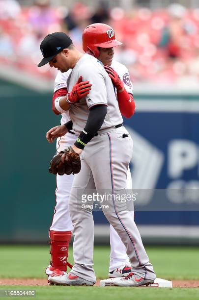 Juan Soto of the Washington Nationals hugs Martin Prado of the Miami Marlins after hitting a double in the second inning at Nationals Park on...