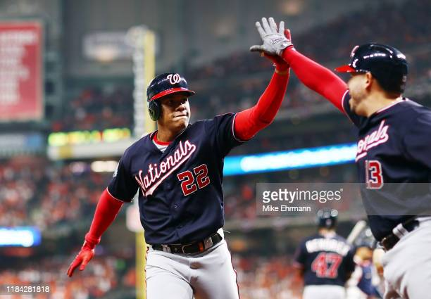 Juan Soto of the Washington Nationals is congratulated by his teammate Asdrubal Cabrera after hitting a solo home run against the Houston Astros...