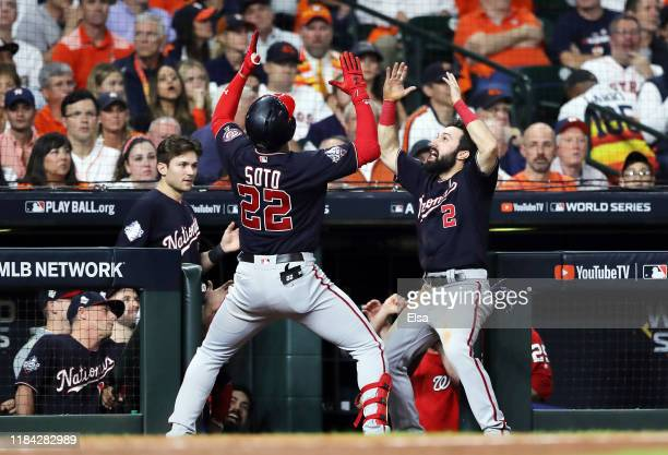 Juan Soto of the Washington Nationals is congratulated by his teammate Adam Eaton after hitting a solo home run against the Houston Astros during the...
